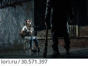 Купить «Serial maniac prepares to kill his female victim», фото № 30571397, снято 19 апреля 2018 г. (c) Tryapitsyn Sergiy / Фотобанк Лори