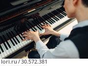 Купить «Pianist playing music on grand piano», фото № 30572381, снято 10 июня 2018 г. (c) Tryapitsyn Sergiy / Фотобанк Лори