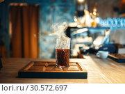 Купить «Glass of fresh hot black coffee, side view», фото № 30572697, снято 24 июня 2018 г. (c) Tryapitsyn Sergiy / Фотобанк Лори