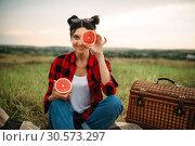 Woman sitting on plaid, picnic in summer field. Стоковое фото, фотограф Tryapitsyn Sergiy / Фотобанк Лори