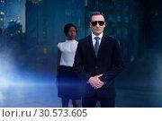 Personal bodyguard of black business woman. Стоковое фото, фотограф Tryapitsyn Sergiy / Фотобанк Лори