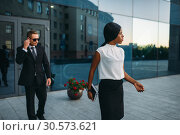 Business woman, bodyguard in suit on background. Стоковое фото, фотограф Tryapitsyn Sergiy / Фотобанк Лори
