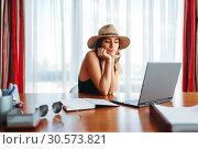 Купить «Woman at table in office thinking about voyage», фото № 30573821, снято 13 августа 2018 г. (c) Tryapitsyn Sergiy / Фотобанк Лори