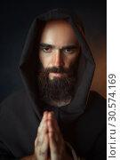 Medieval monk praying with closed eyes. Стоковое фото, фотограф Tryapitsyn Sergiy / Фотобанк Лори