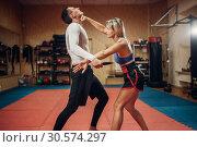 Woman makes punch to the throat, self-defense. Стоковое фото, фотограф Tryapitsyn Sergiy / Фотобанк Лори