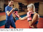 Female kickboxer practicing hand punch. Стоковое фото, фотограф Tryapitsyn Sergiy / Фотобанк Лори