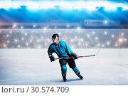 Купить «One hockey player on ice in action, arena», фото № 30574709, снято 20 апреля 2017 г. (c) Tryapitsyn Sergiy / Фотобанк Лори