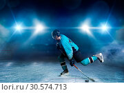 Купить «One hockey player skating on ice arena», фото № 30574713, снято 20 апреля 2017 г. (c) Tryapitsyn Sergiy / Фотобанк Лори
