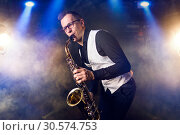 Male saxophonist playing classical music on sax. Стоковое фото, фотограф Tryapitsyn Sergiy / Фотобанк Лори