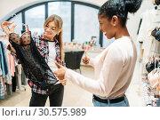 Two women choosing intimate apparel, shopping. Стоковое фото, фотограф Tryapitsyn Sergiy / Фотобанк Лори