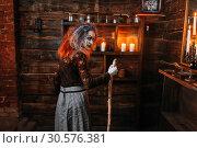Купить «Scary witch with a cane, back view», фото № 30576381, снято 29 января 2019 г. (c) Tryapitsyn Sergiy / Фотобанк Лори