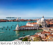 Купить «Panoramic view on Venice and the Basilica Santa Maria della Salute from the bell tower of St. Mark's Cathedral, Italy», фото № 30577105, снято 16 апреля 2017 г. (c) Наталья Волкова / Фотобанк Лори