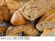 Купить «Cut wholegrain baguette with bakery products», фото № 30578585, снято 30 января 2018 г. (c) Яков Филимонов / Фотобанк Лори