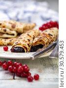 Norwegian pancakes stuffed with berry jam. Стоковое фото, фотограф Марина Сапрунова / Фотобанк Лори