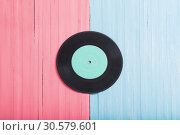 Купить «Music records on pink and blue wooden background. Retro music concept», фото № 30579601, снято 12 апреля 2019 г. (c) Майя Крученкова / Фотобанк Лори