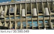 Купить «Santiago Bernabeu Stadium in Madrid, Spain», видеоролик № 30580049, снято 17 января 2018 г. (c) Данил Руденко / Фотобанк Лори