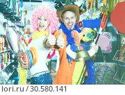 Купить «Smiling man and woman happy with the purchases», фото № 30580141, снято 11 апреля 2017 г. (c) Яков Филимонов / Фотобанк Лори