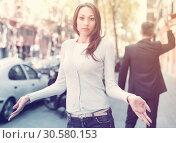 Купить «Young brunette in quarrel with boyfriend», фото № 30580153, снято 11 апреля 2017 г. (c) Яков Филимонов / Фотобанк Лори