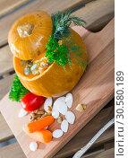 Купить «Recipe of squash soup in baked pumpkin», фото № 30580189, снято 20 апреля 2019 г. (c) Яков Филимонов / Фотобанк Лори