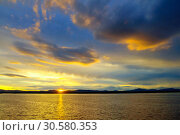 Купить «Sea landscape - sea waters lit by sunset summer light. Sea summer nature with mountain range and colorful clouds», фото № 30580353, снято 26 августа 2013 г. (c) Зезелина Марина / Фотобанк Лори
