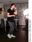 Купить «Jimi Blue showcase to promote his upcoming EP '3LUE' and song 'Schuetteln' at Hard Rock Cafe at Kurfuerstendamm. Featuring: Jimi Blue Ochsenknecht Where...», фото № 30592597, снято 12 июня 2017 г. (c) age Fotostock / Фотобанк Лори