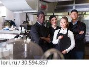 Купить «Group of chefs in kitchen of restaurant», фото № 30594857, снято 24 сентября 2018 г. (c) Яков Филимонов / Фотобанк Лори