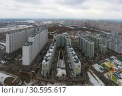 Купить «New high-rise residential buildings in the new neighborhood of Moscow. Aerial view City of Lyubertsy, Moscow Region, Russia», фото № 30595617, снято 17 марта 2019 г. (c) Mikhail Starodubov / Фотобанк Лори