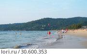 Купить «Azure waves rolled on the sand of Karon Beach», видеоролик № 30600353, снято 26 ноября 2018 г. (c) Игорь Жоров / Фотобанк Лори
