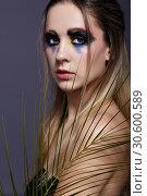 Купить «Female portrait with palm branch leaves on foreground and beauty face makeup.», фото № 30600589, снято 4 марта 2019 г. (c) Serg Zastavkin / Фотобанк Лори
