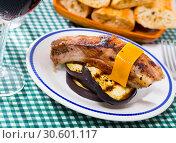 Купить «Roasted pork rib with cheese and eggplant», фото № 30601117, снято 26 мая 2019 г. (c) Яков Филимонов / Фотобанк Лори