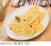 Купить «Delicious appetizing ravioli with bay leaf and black pepper», фото № 30601121, снято 21 августа 2019 г. (c) Яков Филимонов / Фотобанк Лори