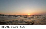 Купить «Sea wave is slowly floating towards the camera at sunset - Split level, Indian Ocean, Hikkaduwa; Sri Lanka», видеоролик № 30601525, снято 26 марта 2019 г. (c) Некрасов Андрей / Фотобанк Лори