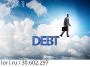 Купить «Debt and loan concept with businessman walking on tight rope», фото № 30602297, снято 17 ноября 2019 г. (c) Elnur / Фотобанк Лори