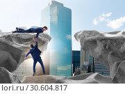 Купить «Businessman offering helping hand to falling colleague», фото № 30604817, снято 26 июня 2019 г. (c) Elnur / Фотобанк Лори