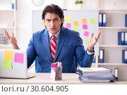 Купить «Young male handsome employee in conflicting priorities concept», фото № 30604905, снято 7 января 2019 г. (c) Elnur / Фотобанк Лори