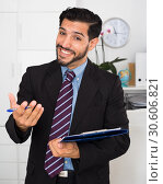 Купить «Smiling man is talking about contract», фото № 30606821, снято 29 июля 2017 г. (c) Яков Филимонов / Фотобанк Лори