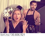 Купить «Woman shocked by the work makeup artist», фото № 30606921, снято 25 апреля 2019 г. (c) Яков Филимонов / Фотобанк Лори