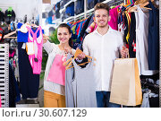Купить «couple boasting various purchases in sports store», фото № 30607129, снято 22 ноября 2016 г. (c) Яков Филимонов / Фотобанк Лори
