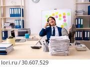 Купить «Young businessman working in the office», фото № 30607529, снято 28 декабря 2018 г. (c) Elnur / Фотобанк Лори