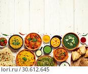 Купить «Indian food and indian cuisine dishes, copy space», фото № 30612645, снято 16 апреля 2019 г. (c) Ольга Сергеева / Фотобанк Лори