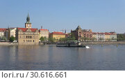 Купить «Прогулочный ретро кораблик на реке Влтава апрельским солнечным утром. Прага, Чехия», видеоролик № 30616661, снято 21 апреля 2018 г. (c) Виктор Карасев / Фотобанк Лори