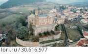 Купить «Aerial view of impressive medieval castle of Chateau de Bouzols on hill in commune of Arsac-en-Velay, France», видеоролик № 30616977, снято 29 января 2019 г. (c) Яков Филимонов / Фотобанк Лори