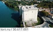 Купить «Aerial view of medieval fortified Chateau de Tarascon and Rhone river at sunny day», видеоролик № 30617001, снято 24 октября 2018 г. (c) Яков Филимонов / Фотобанк Лори