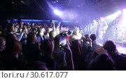 Купить «Sergey Mikhalok, frontman of rock band Lyapis-98, performing song at Sala Apolo, Barcelona», видеоролик № 30617077, снято 22 ноября 2018 г. (c) Яков Филимонов / Фотобанк Лори
