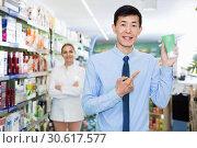 Купить «Portrait of korean man client who is satisfied of recommended medicines in pharmacy.», фото № 30617577, снято 26 марта 2018 г. (c) Яков Филимонов / Фотобанк Лори