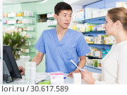 Купить «Adult woman is asking pharmacist about medicines», фото № 30617589, снято 26 марта 2018 г. (c) Яков Филимонов / Фотобанк Лори