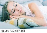 Купить «Girl sleeping on sofa», фото № 30617653, снято 24 июня 2017 г. (c) Яков Филимонов / Фотобанк Лори