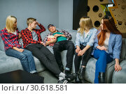 Teenagers waiting for showtime in cinema hall. Стоковое фото, фотограф Tryapitsyn Sergiy / Фотобанк Лори