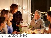 Купить «happy family having birthday party at home», фото № 30619105, снято 15 декабря 2018 г. (c) Syda Productions / Фотобанк Лори