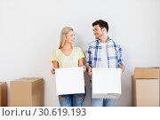 Купить «happy couple with boxes moving to new home», фото № 30619193, снято 25 февраля 2016 г. (c) Syda Productions / Фотобанк Лори